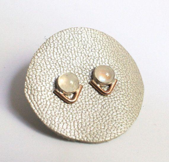 """<a href=""""https://www.etsy.com/listing/275367252/rainbow-moonstone-earrings-in-sterling?ref=finds_l"""" target=""""_blank"""">Get it here</a>."""