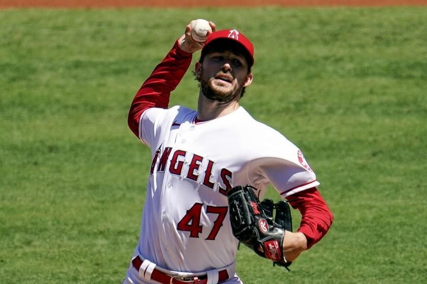 Los Angeles Angels starting pitcher Griffin Canning throws to the Seattle Mariners.