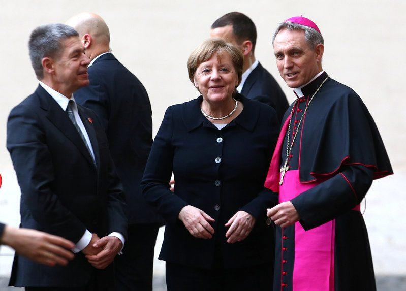 Joachim Sauer as they arrive for a meeting with Pope Francis at the Vatican March 24, 2017.  - Credit: REUTERS/Alessandro Bianchi
