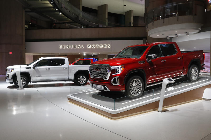 FILE- This Jan. 16, 2019, file photo shows a GMC Sierra pickup, left, and Denali in Detroit. General Motors' posted an $8.1 billion net profit last year as it got better prices for vehicles sold in the U.S., its most lucrative market. The performance was far better than the previous year, when the company lost $3.9 billion due to a giant tax accounting charge.(AP Photo/Paul Sancya, File)