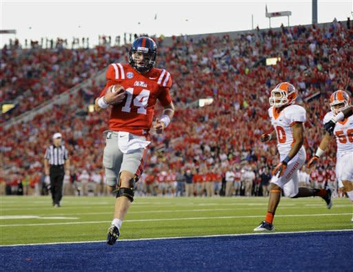 Mississippi quarterback Bo Wallace (14) runs four yards into the end zone late in the second quarter during an NCAA college football game against UTEP in Oxford, Miss., Saturday, Sept. 8, 2012. (AP Photo/Austin McAfee)