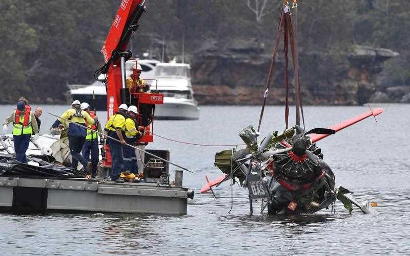 NSW police and salvage personnel work to recover the wreckage of a seaplane that crashed into Jerusalem Bay, north of Sydney.