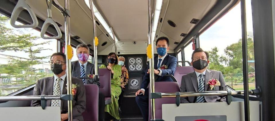 Sarawak Tourism, Arts, and Culture Minister Datuk Abdul Karim Rahman Hamzah (seated, left) aboard an electric bus after its launch in Kuching March 2, 2021. — Picture courtesy of the Sarawak Information Department