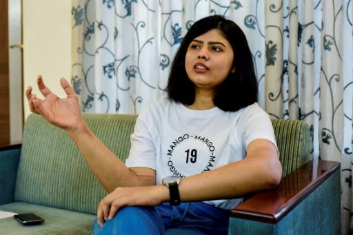 Shreya Siddanagowder gestures during an interview with AFP at her home in Pune, more than two years after she had both hands transplanted