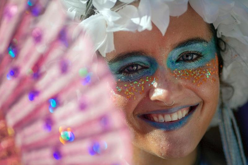 """A reveller from the """"Ceu Na Terra"""" (Heaven on Earth) group performs at the """"bloco"""" in Rio's Santa Teresa neighborhood -- most groups look for private sponsors to fund their activities (AFP Photo/MAURO PIMENTEL)"""