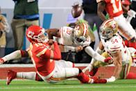 MIAMI, FLORIDA - FEBRUARY 02: Patrick Mahomes #15 of the Kansas City Chiefs is tackled by Jimmie Ward #20 of the San Francisco 49ers during the first quarter in Super Bowl LIV at Hard Rock Stadium on February 02, 2020 in Miami, Florida. (Photo by Andy Lyons/Getty Images)