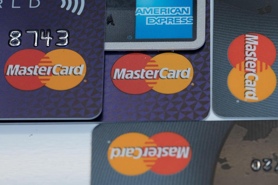 Debts on credit cards can quickly grow to become a problem. Getty Images