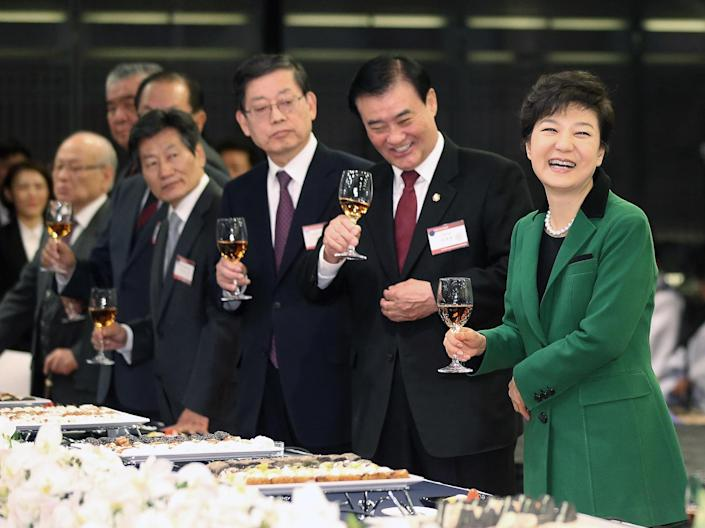 South Korea's new President Park Geun-hye, right, smiles during the Presidential Inaugural Reception in Seoul, South Korea, Monday, Feb. 25, 2013. Park took office as South Korea's first female president Monday, returning to the presidential mansion she had known as the daughter of a dictator, and where she will respond to volatile North Korea, which tested a nuclear device two weeks ago. (AP Photo/Yonhap, Ahn Jung-hwan) KOREA OUT