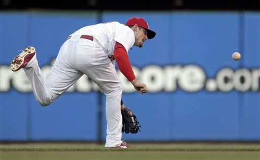 St. Louis Cardinals second baseman Tyler Greene cannot reach a ball hit for a single by San Diego Padres' Yonder Alonso during the second inning of a baseball game, Monday, May 21, 2012, in St. Louis. (AP Photo/Jeff Roberson)