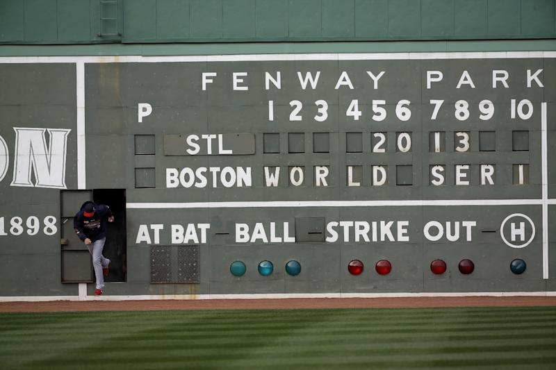 St. Louis Cardinals' Michael Wacha runs out of a scoreboard under the Green Monster before batting practice for Game 1 of baseball's World Series against the Boston Red Sox Tuesday, Oct. 22, 2013, in Boston. (AP Photo/David J. Phillip)