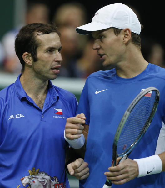 Czech Republic's Tomas Berdych, right, talks to his teammate Radek Stepanek, left, during their tennis Davis Cup final doubles match against Spain's Marcel Granollers and Marc Lopez in Prague, Czech Republic, Saturday, Nov. 17, 2012. (AP Photo/Petr David Josek)
