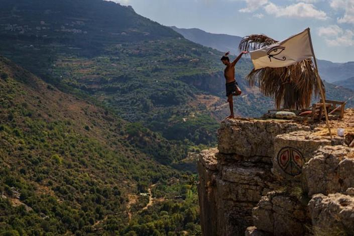 BISRI VILLAGE, LEBANON -- OCTOBER 1, 2020: Imad Baaini stretches and workout at his enclave on a cliff, at Bisri Village, Lebanon, Thursday Oct. 1, 2020. (Marcus Yam / Los Angeles Times)