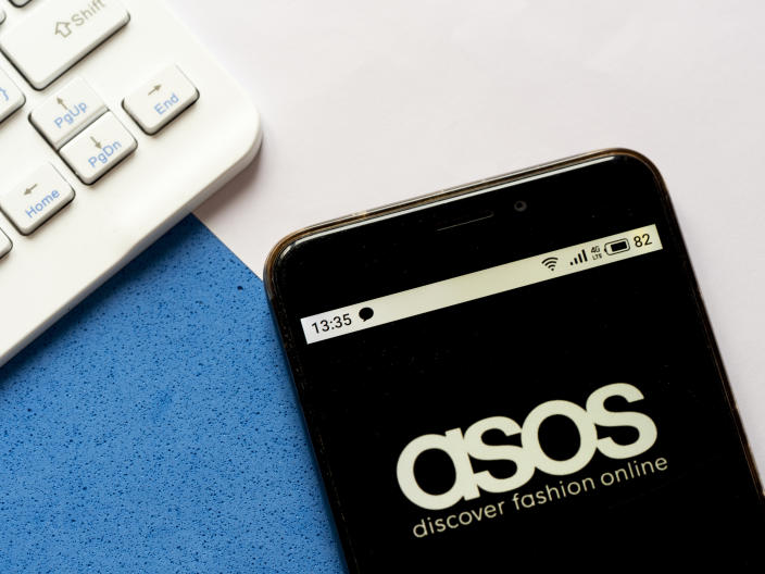 UKRAINE - 2020/04/25: In this photo illustration an Asos logo is seen displayed on a smartphone. (Photo Illustration by Igor Golovniov/SOPA Images/LightRocket via Getty Images)