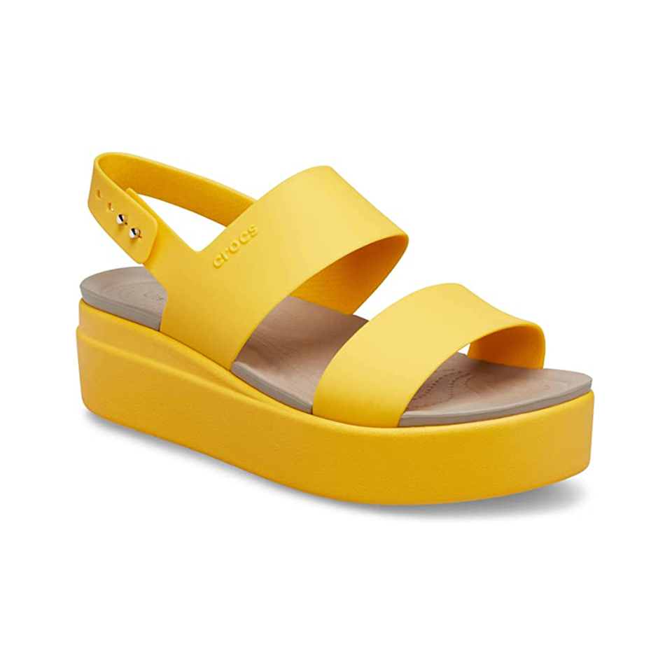 """Want something that screams optimism? Look no further than this ray of sunshine. <a href=""""https://www.glamour.com/story/victoria-beckham-might-wear-this-pair-of-crocs-in-public-and-we-have-justin-bieber-to-thank?mbid=synd_yahoo_rss"""" rel=""""nofollow noopener"""" target=""""_blank"""" data-ylk=""""slk:Crocs"""" class=""""link rapid-noclick-resp"""">Crocs</a> are known to be one of the most comfortable shoes in the world, so adding a pair to your sandal collection seems like a no-brainer. $40, Amazon. <a href=""""https://www.amazon.com/Crocs-Brooklyn-Low-Wedge-Black/dp/B07YQRBJBV"""" rel=""""nofollow noopener"""" target=""""_blank"""" data-ylk=""""slk:Get it now!"""" class=""""link rapid-noclick-resp"""">Get it now!</a>"""