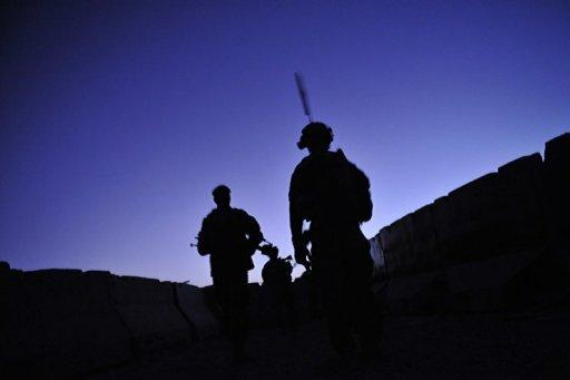 US troops and Afghan National Army soldiers conduct a joint security dawn patrol in 2011
