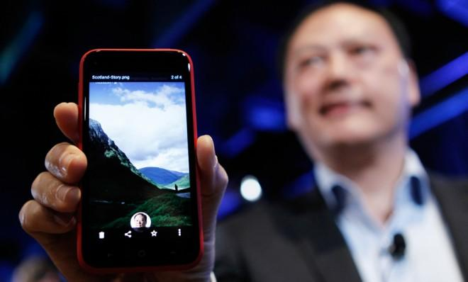 "HTC CEO Peter Chou holds the new Android program Facebook Home, which, according to some, is ""off to a rough start."""