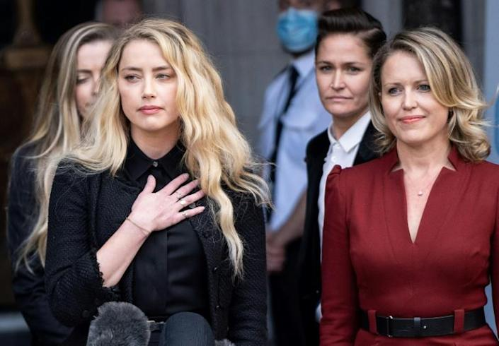 'It has been incredibly painful to relive the breakup of my relationship,' Amber Heard told reporters outside court (AFP Photo/Niklas HALLE'N)