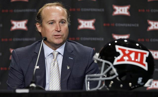 West Virgina head coach Dana Holgorsen answers a question from a reporter during the NCAA college Big 12 Conference football media days in Dallas, Tuesday, July 22, 2014. (AP Photo)