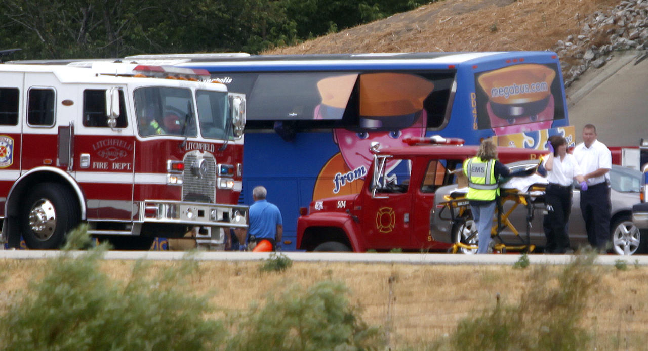 First responders work the scene of a charter bus crash on Interstate 55 near Litchfield, Ill. Thursday, Aug. 2, 2012. Illinois State Police say at least one person has died after the double-decker Megabus carrying 81 passengers blew a tire and slammed head-on into a concrete bridge support pillar. Officials say more than two dozen other passengers in varying conditions are being treated at hospitals. At least four have been flown by helicopter to a trauma center. (AP Photo/The State Journal-Register, David Spencer)