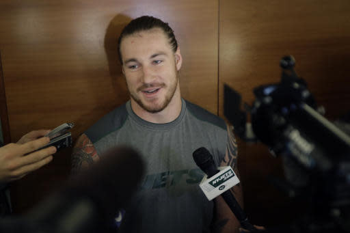 "FILE - In this May 5, 2017, file photo, New York Jets' Dylan Donahue speaks to reporters during NFL football rookie minicamp in Florham Park, N.J. The 25-year-old Donahue was arrested and charged with drunken driving early on Feb. 26 after police say he drove the wrong way in the Lincoln Tunnel in New Jersey and collided with a jitney bus, injuring four people. Donahue ""definitely"" considered the incident a wake-up call, and soon after checked himself into a substance-abuse treatment facility in Jacksonville, Fla., after his second DUI arrest in less than a year. (AP Photo/Julio Cortez, File)"