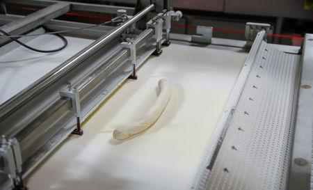 Dough moves along the production line at the Gonnella Baking Company in Aurora, Illinois, U.S., November 16, 2017. Picture taken November 16, 2017. REUTERS/Kamil Krzaczynski