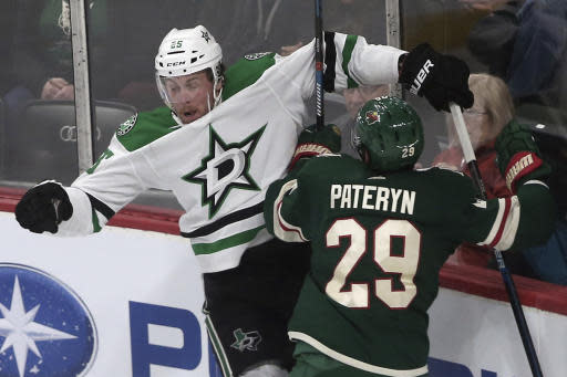 Minnesota Wild's Greg Pateryn, right, checks Dallas Stars' Brett Ritchie into the boards by in the first period of an NHL hockey game Thursday, March 14, 2019, in St. Paul, Minn. (AP Photo/Jim Mone)