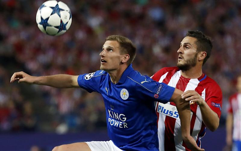 Atletico Madrid's midfielder Koke vies for the ball with Leicester's Marc Albrighton - Credit: EPA/CHEMA MOYA
