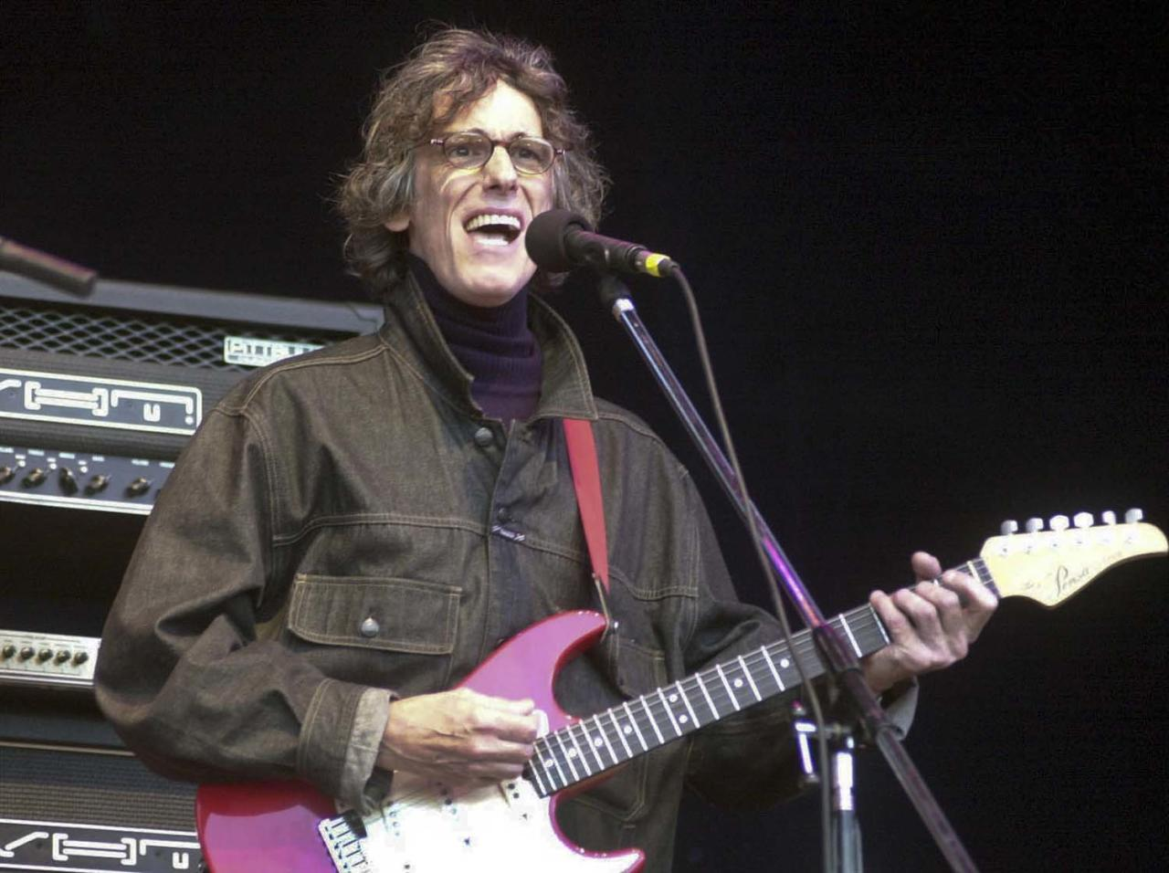 In this photo taken 2007, musician Luis Alberto Spinetta, from Argentina, performs during a concert in Cordoba, Argentina. Spinetta died in Buenos Aires, Argentina on Wednesday, Feb. 8, 2012.  (AP Photo/Irma Montiel, Telam)
