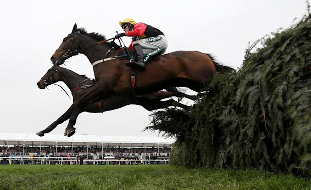 Horse Racing - Grand National Festival - Aintree Racecourse, Liverpool, Britain - April 13, 2018 Ultragold ridden by Harry Cobden clears the last fence on the way to winning the 16:05 Randox Health Topham Handicap Chase REUTERS/Andrew Yates