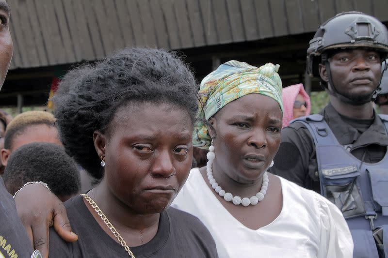 Manyi Tita mourns her 10-year-old daughter who was killed by unidentified assailants in a classroom of a secondary school during a mass funeral in Kumba