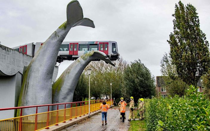 A Dutch metro train was saved from disaster on November 2, 2020, when it smashed through a safety barrier but was prevented from plummeting into water by a sculpture of a whale tail. - AFP