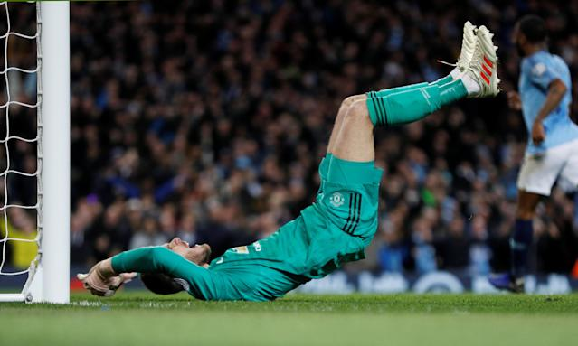"""Soccer Football - Premier League - Manchester City v Manchester United - Etihad Stadium, Manchester, Britain - November 11, 2018 Manchester United's David de Gea reacts after Ilkay Gundogan scores Manchester City's third goal REUTERS/Darren Staples EDITORIAL USE ONLY. No use with unauthorized audio, video, data, fixture lists, club/league logos or """"live"""" services. Online in-match use limited to 75 images, no video emulation. No use in betting, games or single club/league/player publications. Please contact your account representative for further details."""