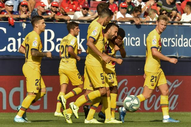 FC Barcelona player Ansu Fati, second right, is congratulated by teammates after scoring during the Spanish La Liga soccer match against Osasuna, at El Sadar stadium, in Pamplona, northern Spain, Saturday, Aug. 31, 2019. (AP Photo/Alvaro Barrientos)