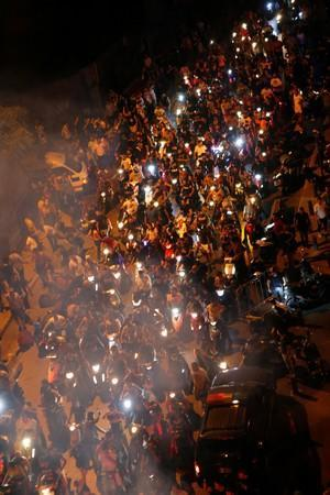 Demonstrators on motorbikes are seen during a protest over deteriorating economic situation in Beirut