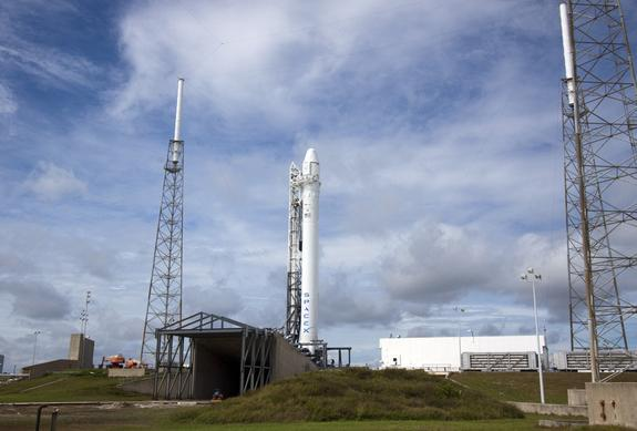 A SpaceX Falcon 9 rocket stands atop its launch pad during preflight preparations to loft a private Dragon space capsule on the first commercial cargo flight to the International Space Station. Liftoff is set for Oct. 7, 2012, at 8:35 p.m. ET f