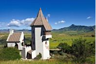"<p>Let down your hair like Rapunzel in the arts town of Clarens with this magical tower. Inspired by the fairytale, Rapunzel's Tower, or the Castle, offers picturesque views of the Maluti Mountains and the flourishing vegetable garden with rampion below. The castle's interiors features decor and treasures from across the world including cornerstones from Windsor Castle.</p><p><a class=""link rapid-noclick-resp"" href=""https://www.castleinclarens.co.za/"" rel=""nofollow noopener"" target=""_blank"" data-ylk=""slk:Book Now"">Book Now</a><br></p>"