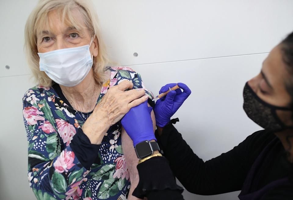 <p>Pharmacist Asha Fowells vaccinates  Catherine Jinadu, aged 82, with her second dose of the Oxford/AstraZeneca coronavirus vaccine, at Copes Pharmacy and Travel Clinic in Streatham, south London.</p> (PA)