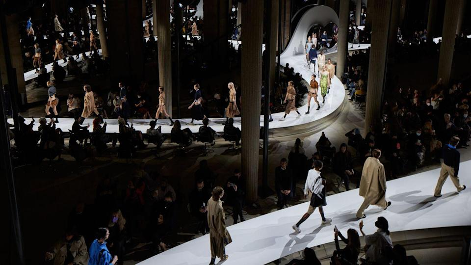<p>It seemed like many brands felt like they had to choose between debuting digital shows via video or in-person runway shows, but you can always count on Miuccia Prada to give the best of both worlds. For the Miu Miu spring 2022 show, the label debuted a short film directed by Meriem Bennani which intermixed with real time footage of the guests at the show, while models walked the runway in an exploration of universal garments. All the essentials were there: khaki jackets, chunky sweaters, and for the Miu Miu girls at heart, heavily embellished slip dresses and perfectly boxy skirt suits covered in shimmering beads. Models marched by in the brand's new collab by New Balance, while the video played in the background on custom-made screens.</p>