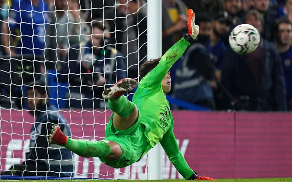 Chelsea goalkeeper Kepa Arrizabalaga saves a penalty during the shoot-out during the Carabao Cup third round match at Stamford Bridge - Mike Egerton/PA