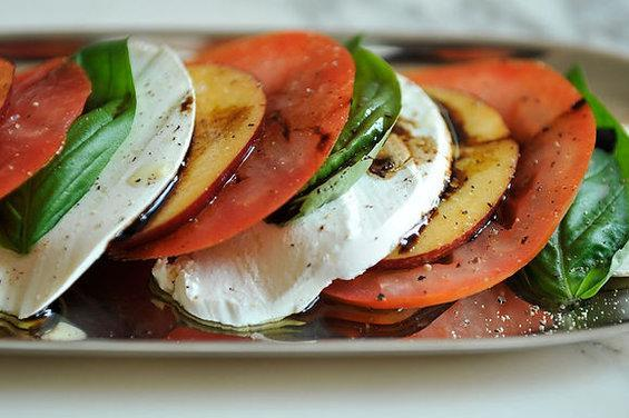 """<div class=""""caption-credit""""> Photo by: Sarah Shatz</div><div class=""""caption-title"""">Tomato, Nectarine and Mozzarella Salad</div><b><a rel=""""nofollow noopener"""" href=""""http://www.food52.com/recipes/310_tomato_nectarine_and_mozzarella_salad"""" target=""""_blank"""" data-ylk=""""slk:Save and print this recipe on FOOD52."""" class=""""link rapid-noclick-resp"""">Save and print this recipe on FOOD52.</a> <br></b> Serves 4 <br> <br> 3-4 tomatoes <br> 2-3 nectarines <br> 1 ball fresh mozzarella <br> 3/4 cups fresh basil leaves <br> extra virgin olive oil (enough to drizzle over the salad) <br> salt and pepper to taste <br> 2-3 tablespoons balsamic vinegar reduced to a syrup (I add a bit of honey before reducing) <br> <br> 1. Slice the tomatoes, nectarines, and mozzarella in wedges of approximately the same size and arrange on a platter with the basil leaves. <br> 2. Drizzle the olive oil over the top and sprinkle salt and pepper to taste. Drizzle the reduced balsamic around the edge of the platter and over the top."""