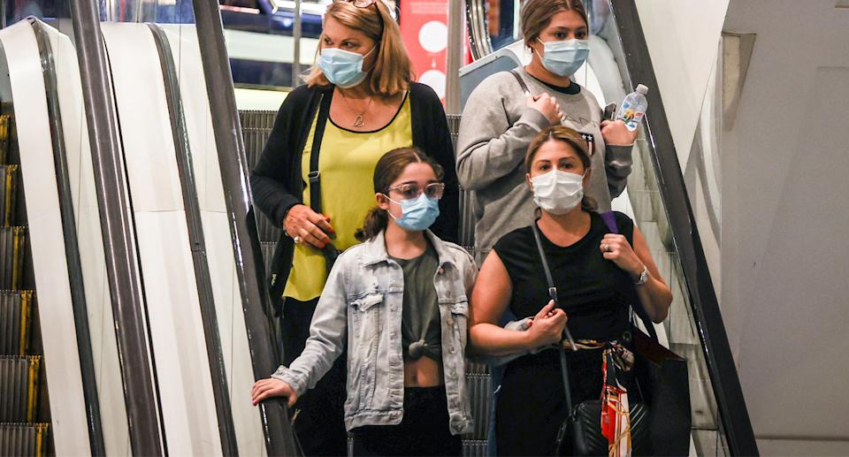 Sydney residents are required to wear face masks until midnight Sunday due to the new infections. Source: AAP