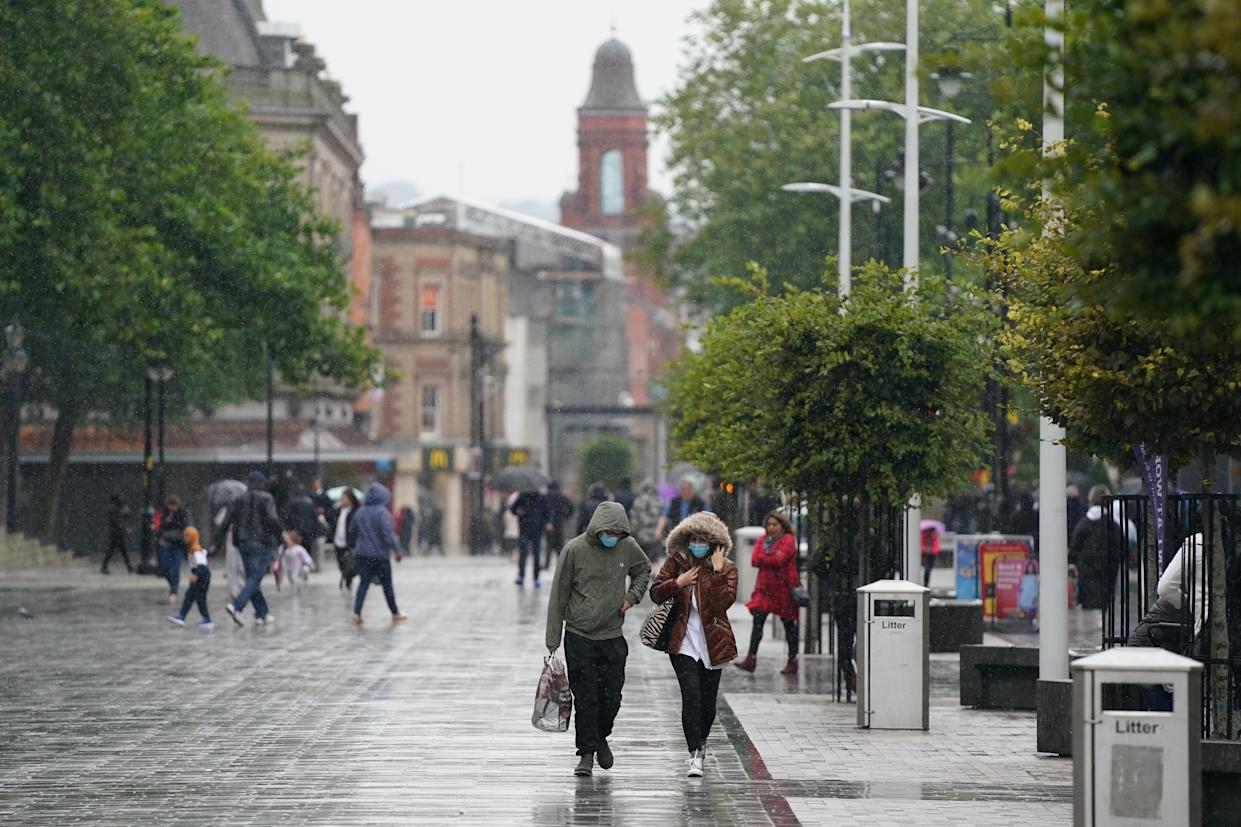 """GREATER MANCHESTER, Sept. 2, 2020-- People walk on the street in Bolton, Greater Manchester, Britain on Sept. 2, 2020. According to BBC, parts of Greater Manchester will not have lockdown restrictions eased as planned following a government U-turn. Measures in Bolton and Trafford were due to be eased overnight after a fall in cases earlier in August. But they will """"now remain under existing restrictions"""" following """"a significant change in the level of infection rates over the last few days"""", the government announced.(Photo by Jon Super/Xinhua via Getty) (Xinhua/Jon Super via Getty Images)"""