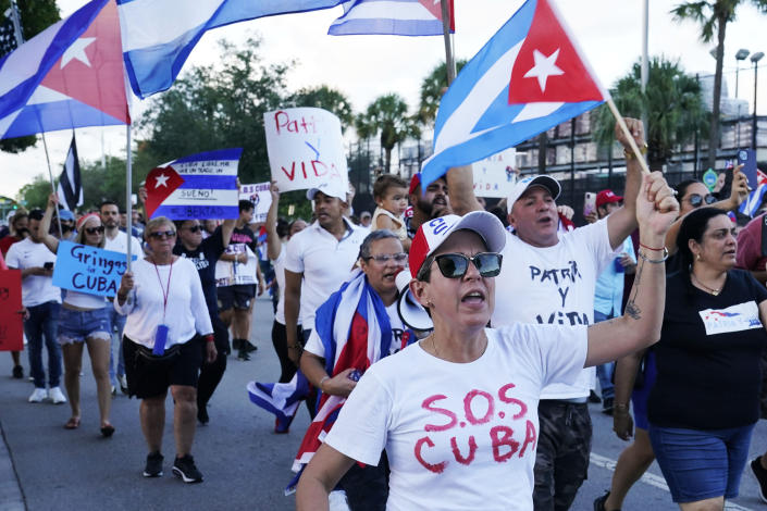 Demonstrators wave Cuban flags and shout their solidarity with the Cuban people and against the communist government, Thursday, July 15, 2021, in Hialeah, Fla. The city of Hialeah has the greatest concentration of Cuban exiles in the U.S. (AP Photo/Marta Lavandier)