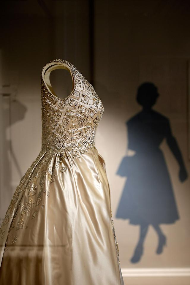 LONDON, ENGLAND - JULY 03: An Evening gown, designed by Norman Hartnell and once worn by the Queen, is displayed in the Fashion Rules Exhibition at Kensington Palace on July 3, 2013 in London, England. The new exhibition will showcase a display of clothes worn by members of the Royal Family in the late twentieth century and opens on July 4. (Photo by Matthew Lloyd/Getty Images)