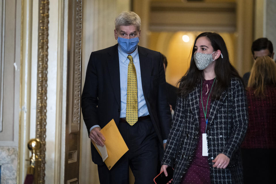 Sen. Bill Cassidy, R-La., walks in the Capitol on the fourth day of the Senate Impeachment trials for former President Donald Trump on Capitol Hill, Friday, Feb 12, 2021 in Washington. (Jabin Botsford/The Washington Post via AP, Pool)