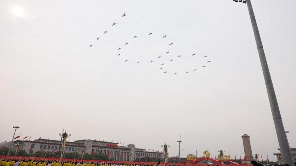 Aircraft from the Chinese People's Liberation Army (PLA) air force fly in formation during a parade to celebrate the the 100th founding anniversary of the Chinese Communist Party at Tiananmen Square on July 1, 2021 in Beijing, China.