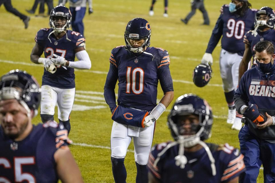 Chicago Bears' Mitchell Trubisky and teammate walk off the field after an NFL football game against the Green Bay Packers Sunday, Jan. 3, 2021, in Chicago. The Packers won 35-16. (AP Photo/Nam Y. Huh)