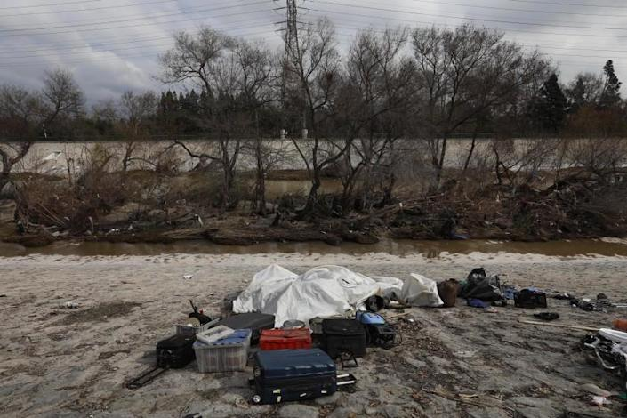 LOS ANGELES, CA - FEBRUARY 1, 2019 - - The belongings of the homeless are left on the Los Angeles River on February 1, 2019. Many homeless people living on an island, in the background, in the middle from the river they move to higher ground before a storm hits.  Homeless people living along the river remember their fellow homeless friend Geoff Garland, who was killed late last year in a murder suicide in Atwater Village.  (Genaro Molina / Los Angeles Times)