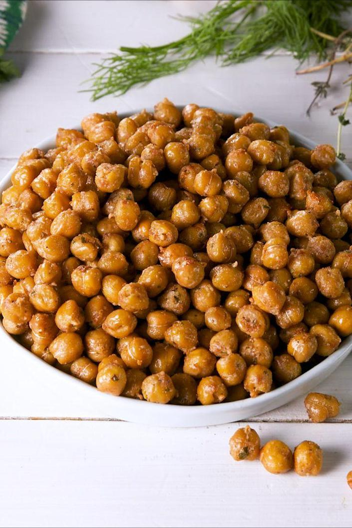 """<p>Satisfy a Doritos craving and fill up on protein at the same time.</p><p>Get the recipe from <a href=""""https://www.delish.com/cooking/recipe-ideas/a27496150/cool-ranch-chickpeas-recipe/"""" rel=""""nofollow noopener"""" target=""""_blank"""" data-ylk=""""slk:Delish"""" class=""""link rapid-noclick-resp"""">Delish</a>.</p>"""