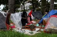 The Wider Image: Clowning is serious business for doctor to homeless in Brazil's 'crackland'